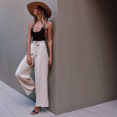 I could spend all summer in this outfit: loose neutral-colored pants, hat and a black swimsuit.