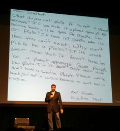 Neil deGrasse Tyson with a hate letter he received from a schoolgirl mad about Plutos demotion - Imgur