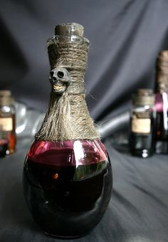 Unlabeled bottles of mysterious ingredients still look awesome. Especially with rope and skulls. Voodoo1 by deadspider