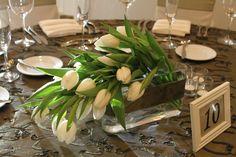 Interesting way to arrange. White tulips are very classy.