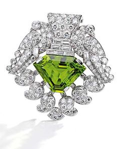 Platinum, peridot and diamond brooch, Cartier, London, circa 1930. Sotheby's | Auctions - Important Jewels 05 Feb. 2015 | Sotheby's