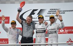 - #NicoRosberg (2nd R) of #Germany and #MercedesGP celebrates on the podium with #ValtteriBottas (L) of Finland and Williams and #LewisHamilton of Great Britain and Mercedes GP after victory in the #GermanGrandPrix at Hockenheimring on July 20, 2014 in #Hockenheim, Germany.