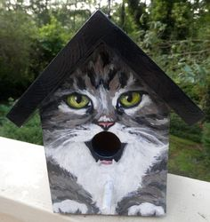 Birdhouse. This bird house is a handpainted EXAMPLE of a grey tabby cat with a black roof. Great gift for people who love cats! Various cat breeds or colors may be custom ordered.  **If you would like to order this as a gift, please let me know and I will not include a receipt in the package. You may also request a note to the recipient to be included.  Hand painted wood with acrylics and sealed with several layers of varnish. Hook is attached at the top for hanging.  Measurements: 9.5…