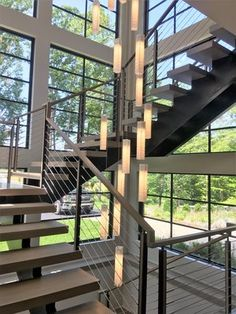 Custom staircase with cable railing Stair Railing Design, Patio Railing, Modern Railing, Cable Railing, Iron Stair Railing, Modern Staircase, Exterior Handrail, Interior Railings, Interior Staircase