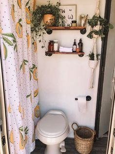 Adding life but not clutter, Jacqueline has adorned the RV with lots of greenery; a papaya-print shower curtain echoes the tiny home's plant life. A woven trash can and wood shelving give the room a chic, organic touch. Apartment Living, Hippie Apartment, Living Room, White Apartment, Apartment Therapy, Home Design, Design Ideas, Design Design, New Homes