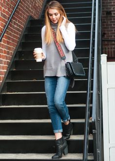 A fall staple, this elongated tunic sweater from RD Style is knitted zippers on each side and a high low hemline for an alluring twist.