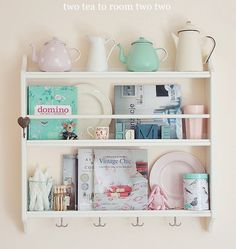 Tea pot collection on decorative plate rack from ikea Pastel Filled Small Apartment Living