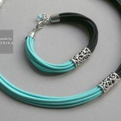 Collier avec en filigrane de métal ,  couleurs: noir, turquoise, argenté