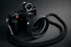 Leica D-LUX 4 equipped with:      Panasonic DMW-LA4  46-52mm stepup ring    52mm protect filter    Voigtländer LH-3 lens hood    Pax view finder for wide conversion lens  Leica hand grip for D-LUX 4