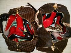 OMG.  This picture is too overwhelming for me.  Louis Vuitton bags and Christian Louboutin heels.  Wow.