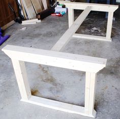 Learn how to build a farmhouse table inspired by ZGallerie's Rencourt dining table. Plans by Ana White, Tutorial by Jen Woodhouse. esstisch How to build a farmhouse table Build A Table, Farmhouse Dining Room Table, Diy Dining Table, White Farmhouse Table, Rustic Table, Farmhouse Ideas, Ana White Farm Table, Kitchen Farm Table, White Wood Table