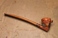 This is an amazing pipe to me. http://www.pipemakersforum.com/forum/viewtopic.php?f=18&t=7812