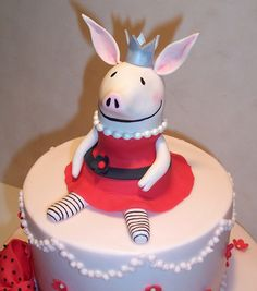 Hooray for Olivia! - This cute pig from  the children's books made for a very fun birthday cake for a little girl turning one.  The party was a pig pickin' (not sure what everyone else calls it - we are in the South!)  and they had lots of red and white decorations.