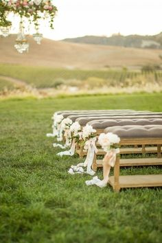 Neutral Vintage Pews with Floral Decor for an Outdoor Wedding | Mike Larson Photography | http://heyweddinglady.com/vintage-winery-wedding-shoot-champagne-gold/