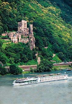 Cruise passing by the Rheinstein Castle standing 300 feet above the Rhine River - Rhineland-Palatinate, Germany