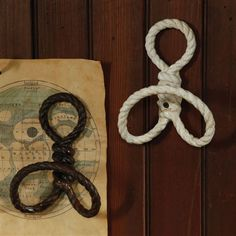 Rope Wall Hook. Twisted metal resembles rope, crafted in a heavy duty cast iron.