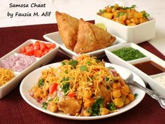 Samosa Chaat is an extremely flavourful snack that is amongst some of the most popular street foods in India. Whenever I make punjabi samosas oraloo samosas, I always save a few to make this dish. It basically consists of a crushed crunchy potato stuffed samosa taht is then topped with channa/chickpeas, yoghurt, sweet and tangy chutneys and some fine sev (gram flour vermicelli). Each bite of this delicious snack is a burst of incredible flavours.
