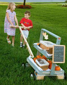 Awesome mobile kid's farmer's market or lemonade stand wagon.