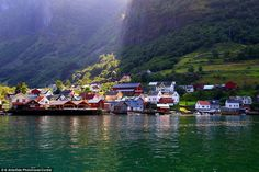 Fairytale village! Undredal is hidden in a narrow valleyin the Aurlandsfjord in Norway, an...