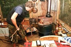 Build a barrel stove (This guy used it in his treehouse!! Maybe a fire hazard, but still fantastic)