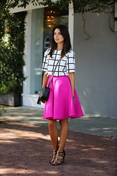 Hot pink midi skirt, white and black pattern top, black and gold heels