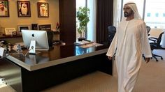 Sheikh Mohammed tours the empty office of an unnamed Dubai government official
