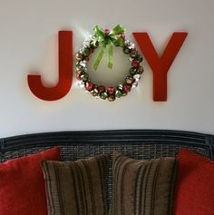 Painted letters from a craft store and a jingle bell wreath