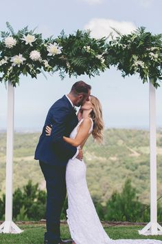 Modern green and white floral ceremony arbour | Kat Stanley Photography | See more: http://theweddingplaybook.com/fresh-and-modern-garden-wedding/