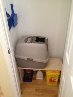 Cat litter box in coat closet. Just put a kitty door in the closet door. This helps to keep the smell in and the kids out.