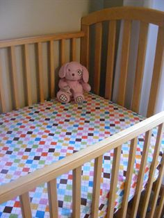 How to make fitted sheets for your kiddos crib! just picked up a bunch of fabric - izzy's bed is a convertible crib bed, so her 'big girl' bed technically is still a crib mattress.  if you have a sewing machine, check this out :-)