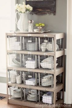 I love the silver tray and flower arrangement on top of shelf!!! so cute!!
