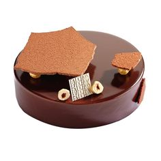 L'éclat [Praliné noisette, d'un crémeux chocolat au lait, d'une compotée d'orange sanguine et d'un glaçage au chocolat au lait. ]   Fauchon
