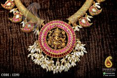 Kanthi necklace, guttupoosalu kanthi necklace along with Ganesh pendant, the outer round circle and mangoes studded with Burmese rubies, For more details please WhatsApp to +91 9393891000 From Swarnsri gold & Diamonds, Vijayawada.