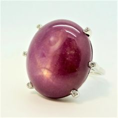 Star ruby with diamond tipped claws dress ring