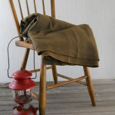 (a few holes & frayed edges)Vintage Green Wool Army Blanket by lisabretrostyle2 on Etsy, $48