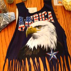 Cut shirt into tank top with fringe for Toby Keith concert!