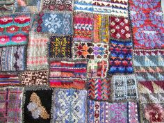 knitted patchwork - mix of patterns, colors and wool - I love it.