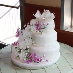 Wedding Cake With Gumpaste Flowers And Swans This is my first attempt at a wedding cake and was made for my son's wedding. It has...