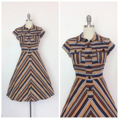 Super cute autumn stripe dress from the late 60s / early 1970s. Slight v-neckline with collar, button up bust & full skirt with back waist tie. Loving the fall colors with chevron stripe design. Medium weight cotton, so she is indeed perfect for fall!   c o n d i t i o n   great - no flaws to note    m e a s u r e m e n t s   fits a modern day size 6 to 8 bust - 37 inches waist - up to 29 inches hips - 44 inches shoulder to waist - 15.5 inches total length - 41 inches fabric - cotton...
