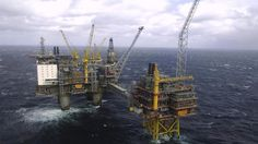 FILE - This April 19, 2007 aerial file photo shows the Oseberg oil platform in the Norwegian sea. After a decade of an oil and gas boom, plunging energy prices are shaking the Norwegians out of a Utopian reverie that guaranteed workers lengthy summer vacations, generous health and social benefits and allowed them to leave work at 4 p.m. and even earlier on Fridays. (AP Photo/NTB Scanpix,  Helge Hansen, File)