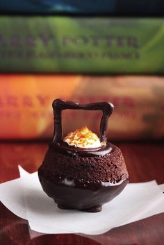 Cauldron Cakes - I might use a little orange zest instead of edible gold glitter ---- this would be awesome for my Harry Potter party
