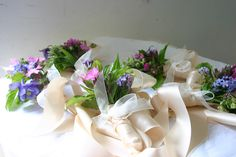 floral bracelets for the wild flower wedding, mid May - grown, cut and tied by @Georgie Newbery at www.commonfarmflowers.com