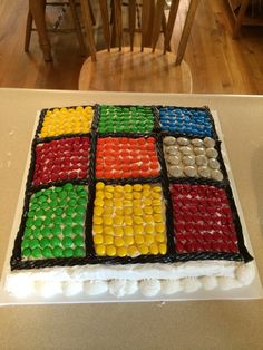 Jonah's Rubik's cube birthday cake made with M&m's and licorice twists.