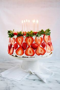 (Love fresh strawberry slices on sides and top of cake with  or without candles - using leaves on the side top row!!)  .... Strawberry cake via 100 Layer Cake