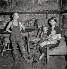 "Children of the Coal: September 1938. ""Coal miner's wife and three of their children. Company house in Pursglove, Scotts Run, West Virginia."" Medium format negative by Marion Post Wolcott"