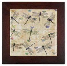 """Dragonflies & Butterflies Ceramic Wall Decoration by Art Plates Home Décor. $24.95. Use for wall art or trivet.. FREE SHIPPING!. 8"""" x 8"""" wood frame with 6"""" x 6"""" ceramic tile insert.. High resolution print.. Non-slip rubber feet. Comes with wall hanging hook.. Our Ceramic Trivets not only make great hot plates, but also make beautiful wall art. These decorative trivets add a special personal touch to any room in your home. We turned the boring, plain trivet and ..."""