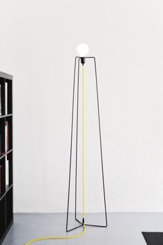 "Simple lines , clean, minimal in perfect harmony with the philosophy of ""less is more "" by the great master MIES VAN DER ROHE . Has a structure composed of 3 vertical feet iron rod (diameter 8mm ) connected centrally together by a door sheet metal bulb."