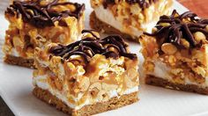 Gooey marshmallows and caramel-coated popcorn and peanuts combine into one decadent sweet-crunchy dessert bar.