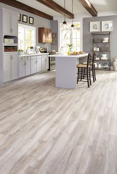 Gray tones mixed with light creams and tans suggest a floor worn over time, evoking a classic yet contemporary style. Check out this featured style!