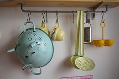 I love this rack/hook set up, and the pastel steel/porcelain cuties.